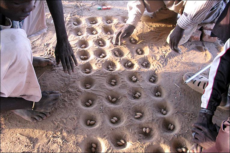 imagen del juego del Mancala en Sudán